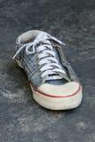 De oude tennisschoen van Jean Stock Fotografie
