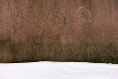 De oude textieldiestof met sneeuw wordt bevlekt Stock Foto's