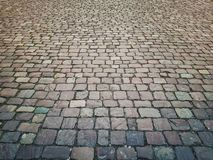 De oude textuur van de steen uitstekende bestrating Het graniet cobblestoned royalty-vrije stock afbeeldingen