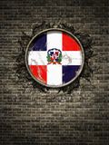 De oude vlag van de Dominicaanse Republiek in bakstenen muur Royalty-vrije Stock Afbeelding