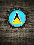 De oude vlag van Heilige Lucia in bakstenen muur Stock Fotografie