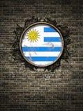 De oude vlag van Uruguay in bakstenen muur Royalty-vrije Stock Foto
