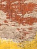 De oude wijnoogst als achtergrond schilderde rood en geel triplex stock foto's