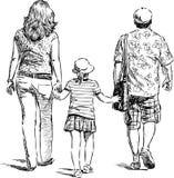 De ouders met hun kind gaan voor gang Royalty-vrije Stock Afbeeldingen