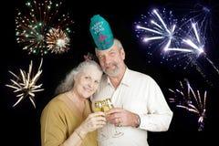 De oudsten vieren Nieuwjaren Stock Foto's
