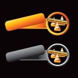 De overgehelde oranje en grijze kegels van de lusjesbouw Stock Afbeeldingen
