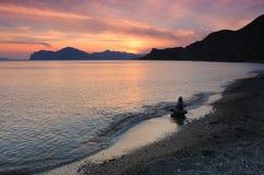 De overzeese zonsondergang van het strand en Royalty-vrije Stock Fotografie