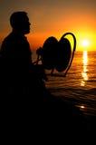 De pêcheur silhouettes vers le bas Images stock