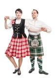 De paarvrouw en man het dansen Schotse dans Royalty-vrije Stock Afbeeldingen