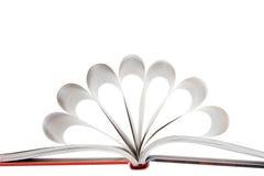 De pagina's van het boek die in een bloemvorm worden gevouwen Stock Afbeelding