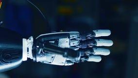 De palm van een mechanisch wapen roteert stock video