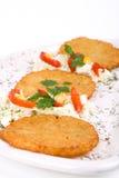 De Pannekoek van de aardappel/de Cake van het Rooster op geïsoleerdea plaat Stock Fotografie