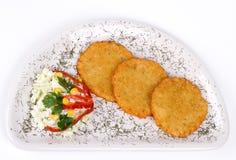 De Pannekoek van de aardappel/de Cake van het Rooster op geïsoleerdeT plaat Stock Fotografie
