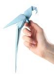De papegaai van de origami op hand Royalty-vrije Stock Afbeelding