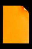 De papel vacío anaranjado A4 aislada en negro Foto de archivo libre de regalías