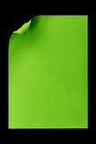 De papel vacío verde A4 aislada en negro Imagen de archivo libre de regalías