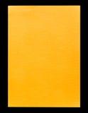 De papier A4 vide orange d'isolement sur le noir Photographie stock libre de droits