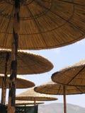 De paraplu's van het strand Stock Afbeeldingen