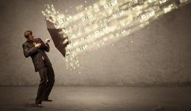 De paraplu van de bedrijfsmensenholding tegen het concept van de dollarregen Royalty-vrije Stock Foto