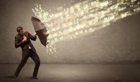 De paraplu van de bedrijfsmensenholding tegen het concept van de dollarregen Stock Fotografie