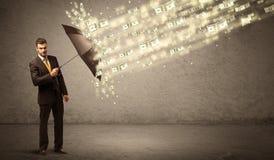 De paraplu van de bedrijfsmensenholding tegen het concept van de dollarregen Royalty-vrije Stock Fotografie