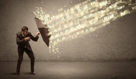 De paraplu van de bedrijfsmensenholding tegen het concept van de dollarregen Royalty-vrije Stock Foto's