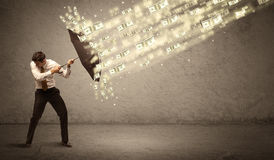 De paraplu van de bedrijfsmensenholding tegen het concept van de dollarregen Stock Afbeelding