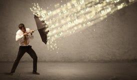 De paraplu van de bedrijfsmensenholding tegen het concept van de dollarregen Stock Afbeeldingen