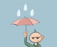 De paraplu van de jongensholding Royalty-vrije Stock Foto's