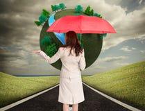 De paraplu van de onderneemsterholding Royalty-vrije Stock Fotografie