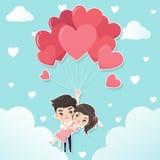 De paren houden harten gevormde ballon royalty-vrije illustratie