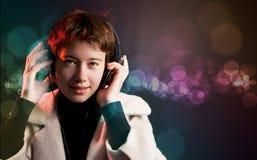 De partijmeisje van Deejay met kleurrijke bokeh Stock Fotografie