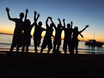 De partijmensen van het strand Stock Afbeelding