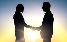 De partners silhouetteert het schudden handen Royalty-vrije Stock Afbeelding
