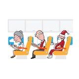 De passagiers van de vliegtuigcabine en slimme telefoons en Kerstman Stock Afbeeldingen