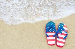 De patriottische achtergrond van de V.S. op het zandige strand Stock Foto