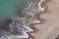 De patronen van de golf in het zand Stock Foto