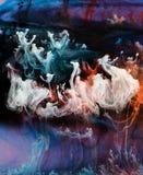 De patronen van de inkt in water stock foto