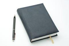 De pen en het notitieboekje van Bldck stock foto