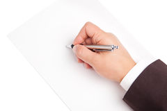 De pen van de handholding op witte achtergrond wordt geïsoleerd die Stock Foto's
