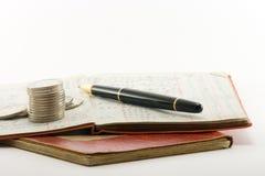 De Pen van het Geld van grootboeken Stock Afbeeldingen