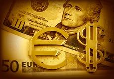 De pengareuroet och dollarna Arkivfoton