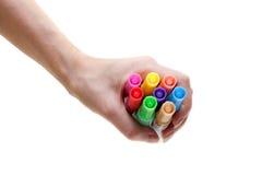 De pennen van het zacht-uiteinde in vrouwelijke hand Stock Afbeeldingen