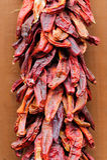 De Peper die van de Spaanse peper Ristra hangen Royalty-vrije Stock Afbeeldingen
