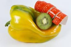 De peper en het meetlint van de kiwi Stock Afbeeldingen