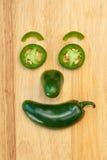 De peper van Jalapeno het glimlachen gezicht Stock Foto's