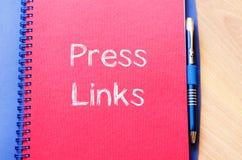 De pers verbindt concept op notitieboekje Stock Foto's