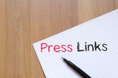 De pers verbindt concept op notitieboekje Stock Afbeeldingen