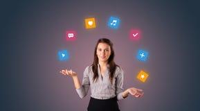 De persoon jongleert met met toepassingspictogrammen royalty-vrije stock afbeeldingen