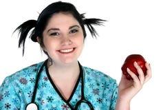 De persoon van de gezondheidszorg met appel stock foto's